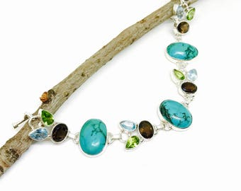 Turquoise ,peridot, smokey quartz, blue topaz multigemstone bracelet set in sterling silver 925. Natural authentic stones. Adjustable length