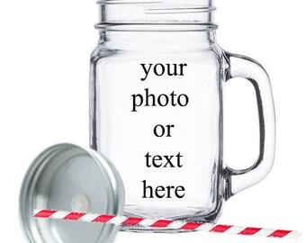 Clear 12 oz mason jar with a straw