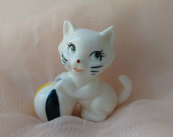 Vintage kitsch kitty cat with ball bone china ornament
