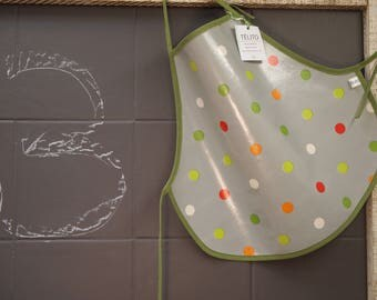 3 years of colorful polka dot oilcloth apron