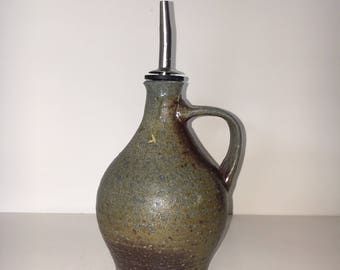 "Ceramic bottle  6.25"" tall without the pouring spout"