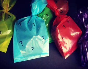 Mystery grab bags. Includes 3 randomly selected pins + 1 sticker.  FREE SHIPPING!