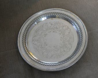 Vintage Silver Platter, WMRogers 160, Could be silver plated However very Heavy.  Gorgeous Ornate Decoration Piercing on the Edges