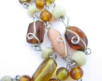 Long GLASS BEADED Vintage NECKLACE  Some Beads Wire Wrapped in Silvertone Metal, Browns, Golds, Creams, Beige, All different shapes & tones