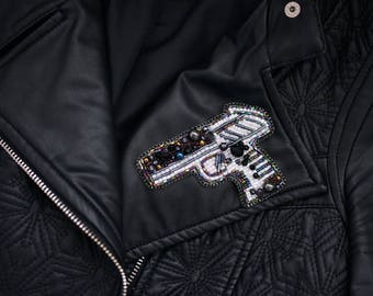 Luxurious beaded gun brooch