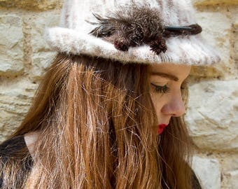 Beige and brown vintage feathered hat