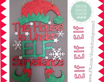 Elf Surveillance Plaque with Hat and Feet by Duck Duck Goose