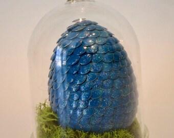 Small dragon egg in cloche