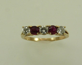 Ruby 0.25ct Ring with Diamonds 14k Yellow Gold