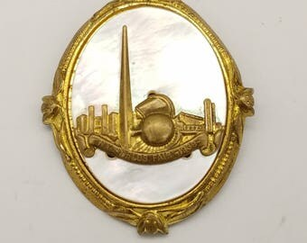 1939 New York Worlds Fair Mother of Pearl & Brass Trylon and Perisphere Souvenir Brooch