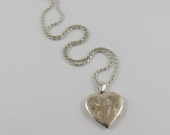 """Sterling Silver Heart Shaped  Locket With An Etched Design And An 18"""" Rope Chain"""