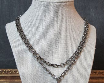Crystal and gunmetal chain necklace.