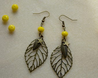 Big earrings leaf with star and yellow bead