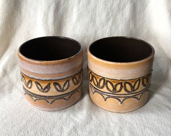 Set of two vintage flower pots, West Germany-brown-yellow-mustard with overprint in relief.