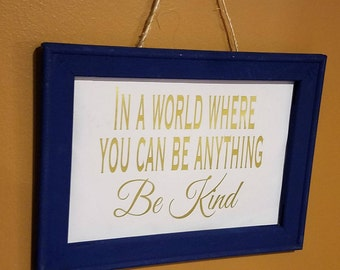 In a world where you can be anything, be kind canvas and wood hand painted wall hanging