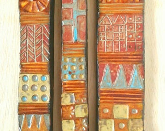Triptych - 3 ceramic tiles with stamped, carved, and drawn pattern, finished with turquoise, olive, gold, and iron brown/green glazes.