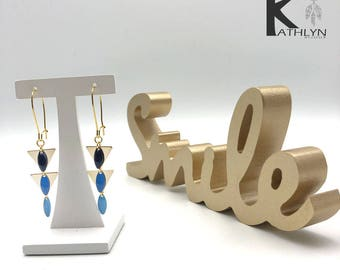 Gold and blue dangling earrings