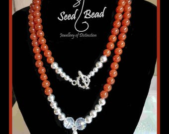 Long red carnelian bead necklace with Swarovsky crystal pendant