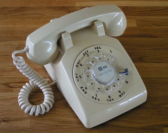 Cream Colour Vintage Rotary Dial Phone made in Canada by the Northern Electric Company in the 1960's