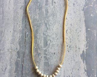 Hammered Arrowhead & Silver on Yellow Suede