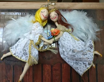 Pendant of the Angels. Two cute angel holding hands. Single copy. Handmade.