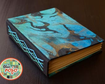 Incredible handmade journal sewn with a variation of the long stitch, marbled thai cover.