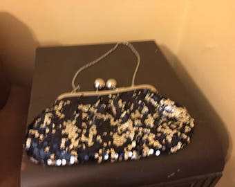Sequinned purse with black silk back and silver clasp chain handle good condition