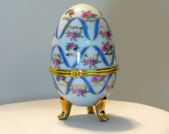 Collectible Porcelain Egg Shaped Trinket Box | Blue, White with Gold Tone Metal Trim Footed | Faberge-Style Gilded Egg