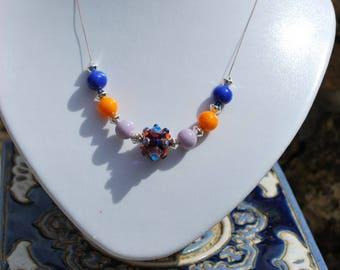 """Necklace """"Tutti frutti"""" blue, orange and purple."""