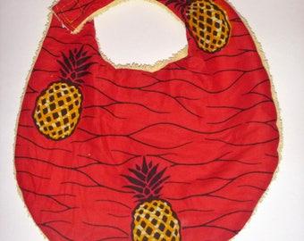 Red and yellow pineapple baby bib