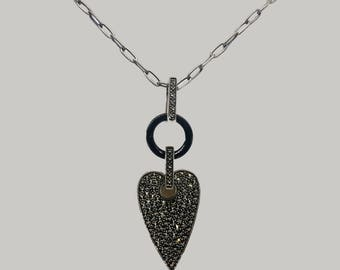 Heart shaped sterling silver pendant with macasites and black link
