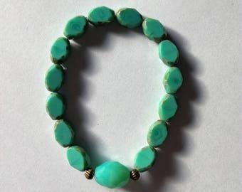Elastic bracelet woman turquoise beads accompanied by bronze