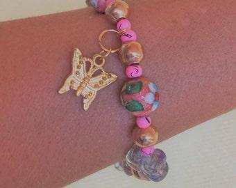 Bracelet with butterfly, glass bracelet with beads, pink bracelet, youth bracelet, pink bracelet, bracelet with beads and butterfly.