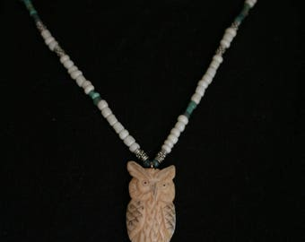 blue and white beaded necklace with resin owl pendant