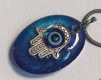 Hand of Fatimah Hamsa surrounding Eye of Protect against Evil Eye Charm in epoxy resin ward off the evil eye
