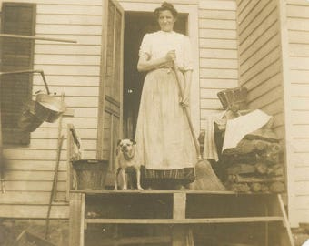 vintage photo 1910 Apron Woman Sweeps Broom on Porch w Her Dog