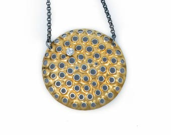 Large 22k gold pendant with cubic zirconia on 17 inch oxidized silver chain.