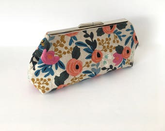 Floral clutch, summer clutch, resort clutch, in pink, orange, blue, navy and gold in fabric by Cotton and Steel designed by Rifle Paper Co