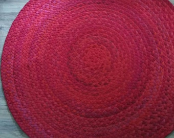"Red hand braided cotton rug 57"" across"