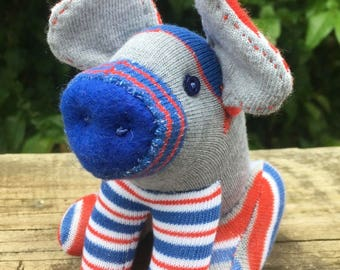 OINKLE SAM wants YOU! This sock toy is a Yankee Doodle Dandy. He's a patriotic porker ready to party.