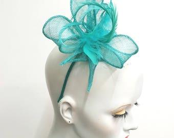 Jade green sinamay fascinator with feathers jade headband weddings