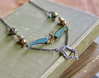Artsy layered bird necklace with patina wings, pearl and glass beads, and metal pendant, Ancient Aviary