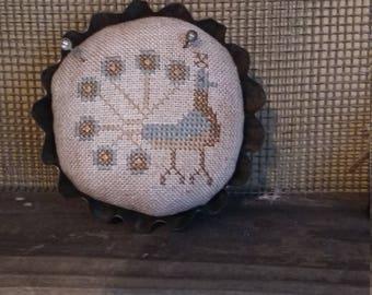 "primitive cross stitch PEACOCK  3 1/2"" round tart tin pin cushion"