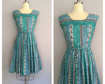 Turquoise tiki dress | 1950s novelty print dress | 50s vintage cotton sun dress | s - m