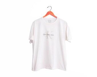 vintage t shirt / Calvin Klein Jeans / CK t shirt / 1990s white Calvin Klein Jeans spell out logo t shirt Medium