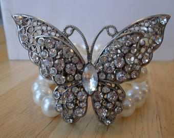 3 Row White Sea Shell Pearl Stretch Cuff Bracelet with a Silver and Clear Rhinestone Butterfly Center