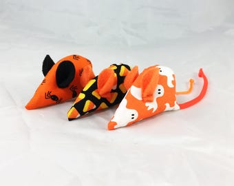 Three Halloween catnip mice, Holiday cat toys, candy corn, black spiders, white ghosts