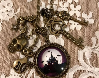 Vintage, Charm, Pendant Necklace Featuring, A Haunted House With Bats. Antique Bronze Tone.