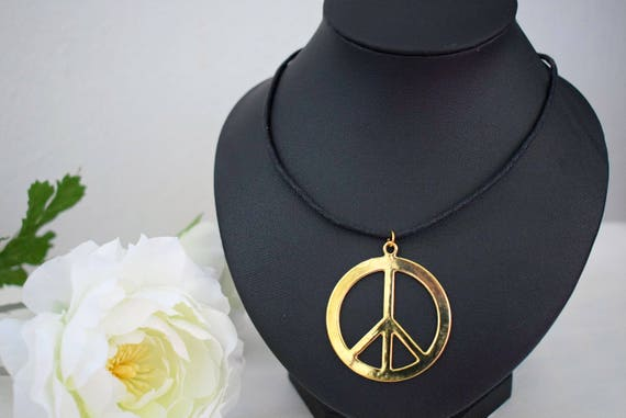 60s -70s Jewelry – Necklaces, Earrings, Rings, Bracelets Gold Peace Necklace - Large Peace Necklace - Adjustable Cord Necklace - Symbolic Jewelry - Boho JewelleryGold Peace Necklace - Large Peace Necklace - Adjustable Cord Necklace - Symbolic Jewelry - Boho Jewellery $14.58 AT vintagedancer.com