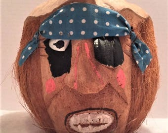 Carved coconut pirate head with eye patch and bandana